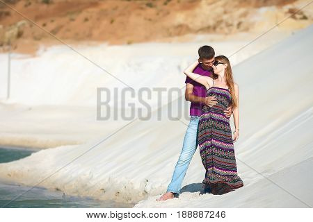 hugging lovers on romantic travel honeymoon vacation summer holidays romance. Young happy lovers, caucasian woman and man embracing outdoors