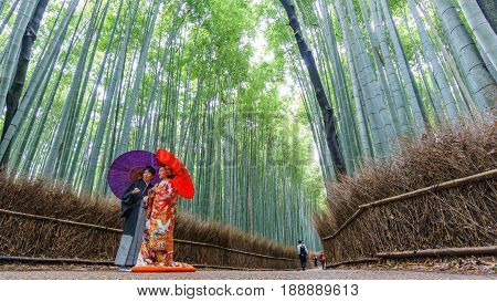 KYOTO, JAPAN - JUNE 9: Unidentified couple stands in bamboo forest, a place for wedding photography in Kyoto on June 9, 2015 in Japan