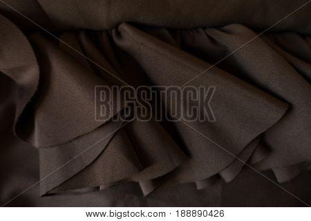 Close Up Of Folded Plain Viscose Chocolate Clored Fabric