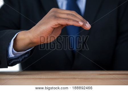 Close-up of businessman protecting invisible object