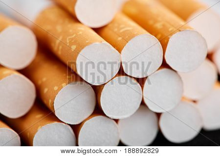 Cigarette Close Up Isolated On Blak Background. Drug Addiction. Tobacco Smoking. Cancer. Nicotine. B