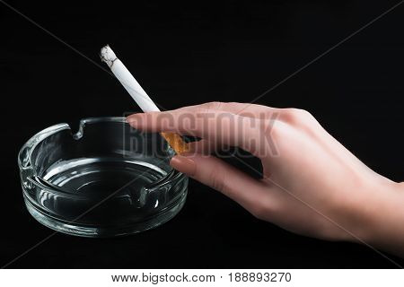 Cigarette With Ashtray On A Black Background. Drug Addiction. Tobacco Smoking. Cancer. Nicotine. Bad