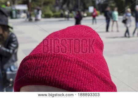 Red Beanie On A Girl`s Head