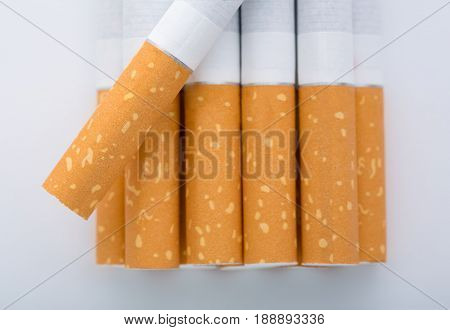 Cigarette Close Up Isolated On White Background. Drug Addiction. Tobacco Smoking. Cancer. Nicotine.