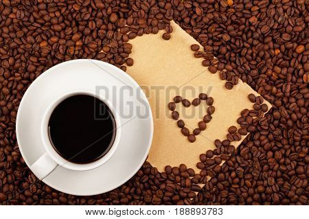 Coffee Cup With Heart Symbol And Paper