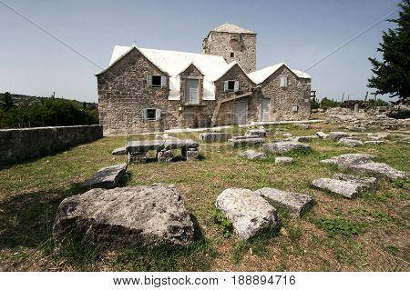 Fort and houses of Museum of island Brac and ancient stone fragments in Skrip in Croatia