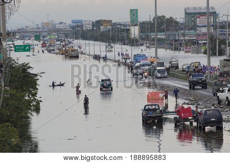 AYUTHAYA THAILAND - OCTOBER 142011 : flood water attack on phahonyothin road cutting main of land transport to north of country