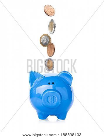 Coins falling into piggy bank on white background. Money savings concept