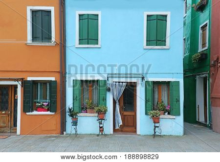 Retro houses with colorful facades and open doors and windows