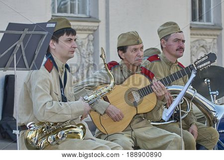 MOSCOW, MAY 9, 2010: Victory solders music band with saxophone, guitar on celebration of Great victory 65th anniversary in Gorky Park. USSR victory in Second World War. 9 May Victory day