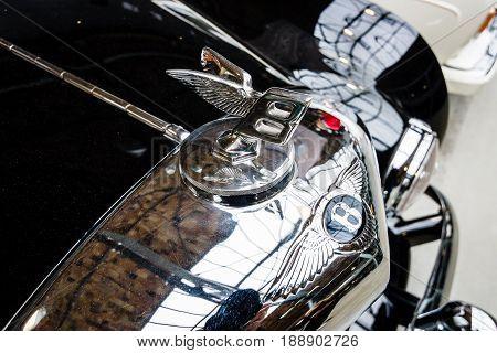 BERLIN - MAY 13 2017: Hood emblem of the luxury car Bentley. Exhibition