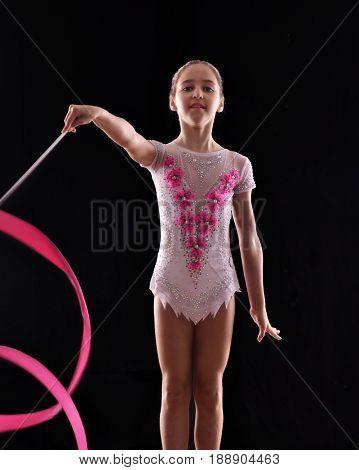 Rhythmic gymnastic girl using a ribbon.
