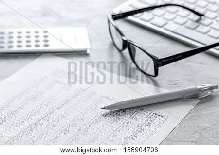 business taxes accounting with calculator in office work space on stone desk background top view