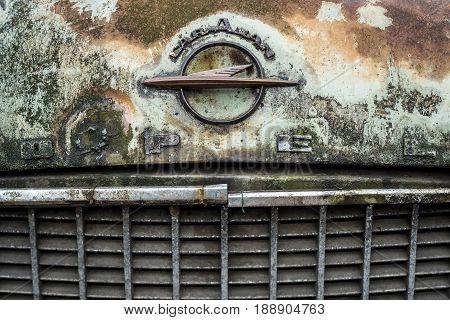 BERLIN - MAY 13 2017: Dirty and rusty hood emblem of Opel (Olympia) Rekord Caravan. Exhibition