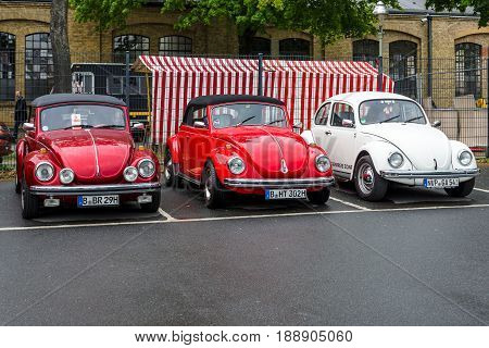 BERLIN - MAY 13 2017: Economy cars Volkswagen Beetle stand in a row. Exhibition