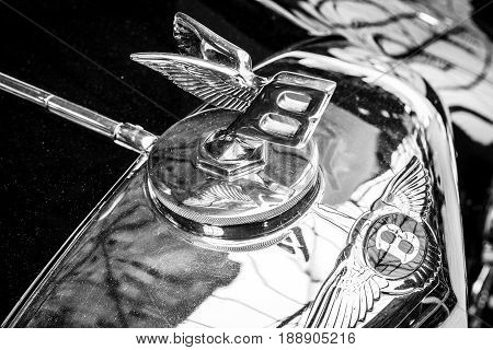 BERLIN - MAY 13 2017: Hood emblem of the luxury car Bentley. Black and white. Exhibition