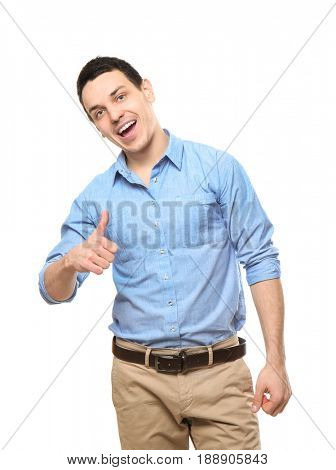 Young happy handsome man showing thumbup on white background