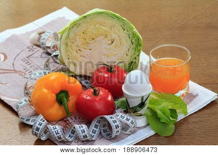 Set Of Fresh Natural Products With Cabbage, Pepper, Tomato, Egg And Multivitamin Juice In Glass