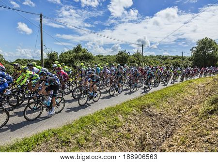 QuinevilleFrance- July 2 2016: The peloton riding during the first stage of Tour de France in Quineville France on July 2 2016.