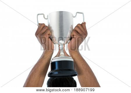 Hand of businessman lifting a trophy against white background