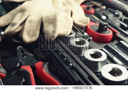 Gloves and toolbox, closeup