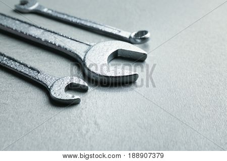 Combination wrenches and spanner on light background