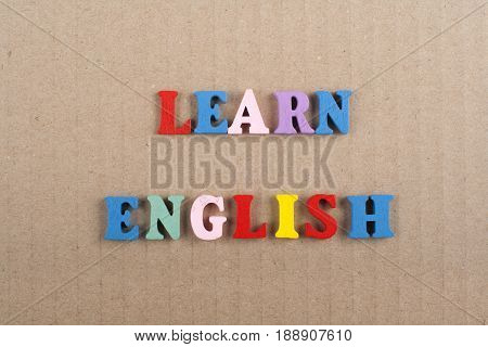 LEARN ENGLISH word on background composed from colorful abc alphabet block wooden letters, copy space for ad text. Learning english concept