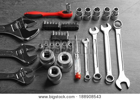 Setting of tools for car repair on grey table