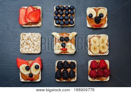 Variation of healthy peanut butter breakfast corn Breads with berries and banana.