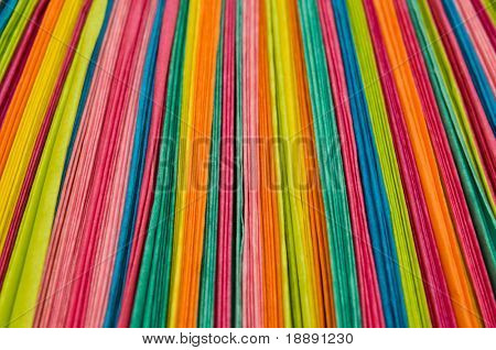 Abstract colorful background of vertical paper stripes big depth of field
