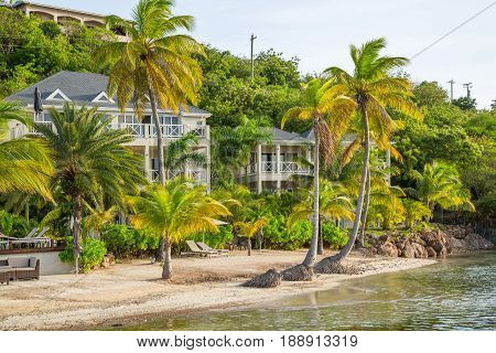 Antigua, Caribbean islands, English Harbour - May 19, 2017:  Sunset in the English Harbour. Palms, beach and holidays apartments