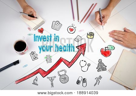 Invest in your health concept. Healty lifestyle background. The meeting at the white office table.
