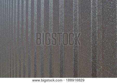 Forged decorative gates broun rough steel background.