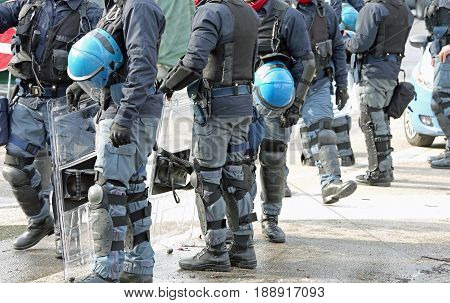Anti-riot Police Cops With Protective Helmet During Patrolling T