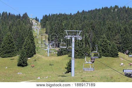 Chair Lift Leading To The Summit Of The Mountain