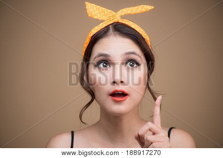 Surprised Asian Girl With Pretty Smile In Pinup Style On Yellow Background