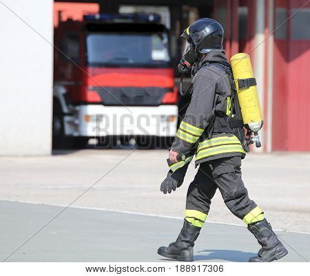 Firefighter With Large Oxygen Cylinder And Automatic Respirator