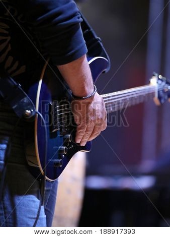 Guitarist And His Guitar In Live Concert