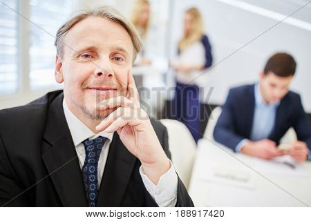 Old businessman as CEO with competence and leadership