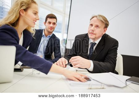 Business team with a manager and a lawyer in a meeting