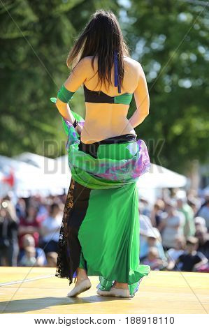 Young Girl While Performing Belly Dance On An Outdoor Stage