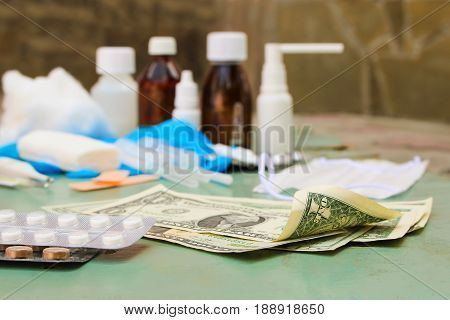 Medical items and money on table. Top view.