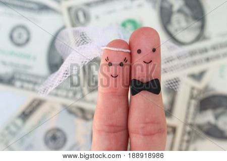 Fingers art of a Happy couple. Bride and groom hug on background of money. Concept of arranged marriage