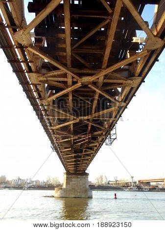 metal construction of old railway bridge, part of bridge across the river