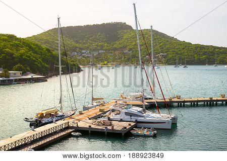 Antigua, Caribbean islands, English Harbour - May 19, 2017:  Sunset in the English Harbour and lots of sailing boats tacked in Marina