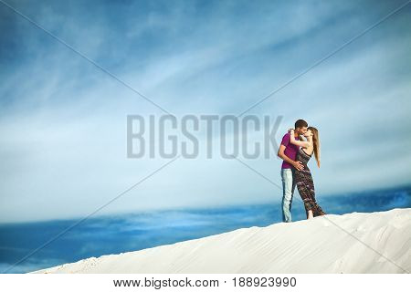 Young couple kissing on top of high mountain. couple on romantic travel honeymoon vacation summer holidays romance.