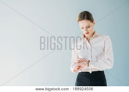 Young Attractive Caucasian Businesswoman In Formalwear Looking At Hand Watches, Isolated On Grey