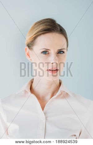 Portrait Of Young Adult Pensive Caucasian Businesswoman In Formalwear, Isolated On Grey