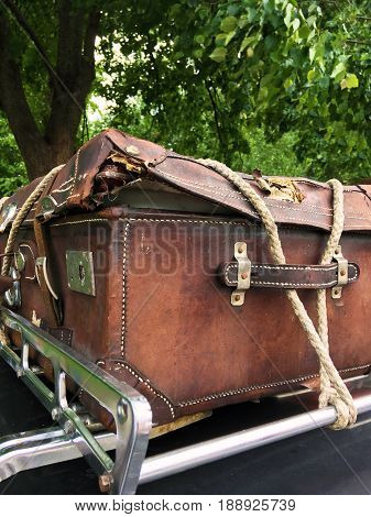 Vintage leather suitcase tied with a rope