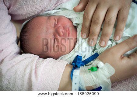 mother calming her new born baby